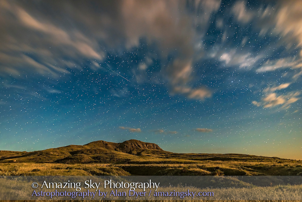 A lone Perseid meteor above 70 Mile Butte, a landmark in Grasslands National Park, Saskatchewan, with the setting waxing gibbous Moon providing the illumination. Thsi was August 11, 2016. This is looking south. Some green bands of airglow tint the sky. These became much more obvious after moonset.<br /> <br /> This is a single exposure, taken as part of a time-lapse sequence. It is a 30-second exposure at f/2 with the 24mm Sigma Art lens and Nikon D750 at ISO 800.
