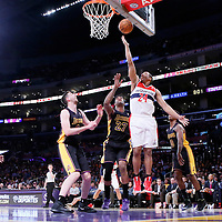 21 March 2014: Washington Wizards guard Andre Miller (24) goes for the layup over Los Angeles Lakers forward Jordan Hill (27) during the Washington Wizards 117-107 victory over the Los Angeles Lakers at the Staples Center, Los Angeles, California, USA.