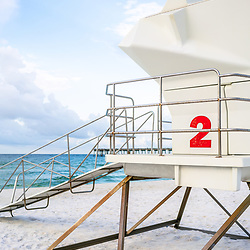 Lifeguard tower two on Casino Beach in Pensacola Beach Florida. Pensacola Beach is on Santa Rosa Island in the Emerald Coast of the Southeastern United States of America. Photo is vertical and high resolution. Copyright ⓒ 2018 Paul Velgos with All Rights Reserved.