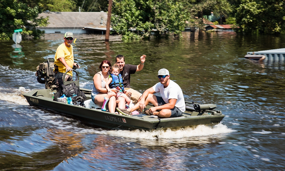 Volenteers helping evacuate a family in Vidor Texas where the water continued to rise days after Hurricane Harvey first made landfall in Texas, in boats.