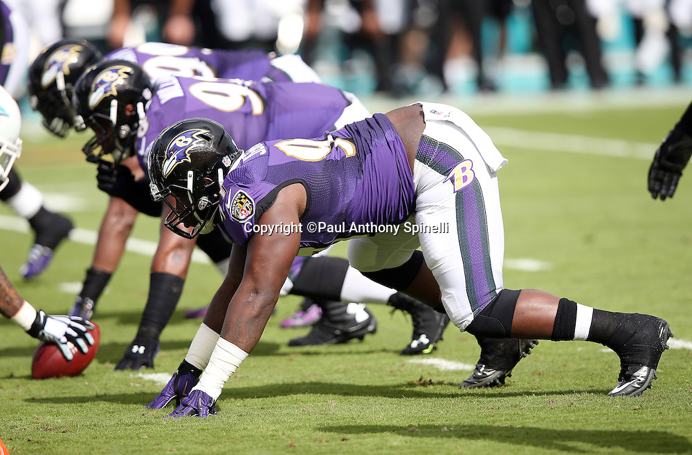Baltimore Ravens defensive end Timmy Jernigan (97) gets set for the snap in a four point stance at the line of scrimmage during the 2015 week 13 regular season NFL football game against the Miami Dolphins on Sunday, Dec. 6, 2015 in Miami Gardens, Fla. The Dolphins won the game 15-13. (©Paul Anthony Spinelli)