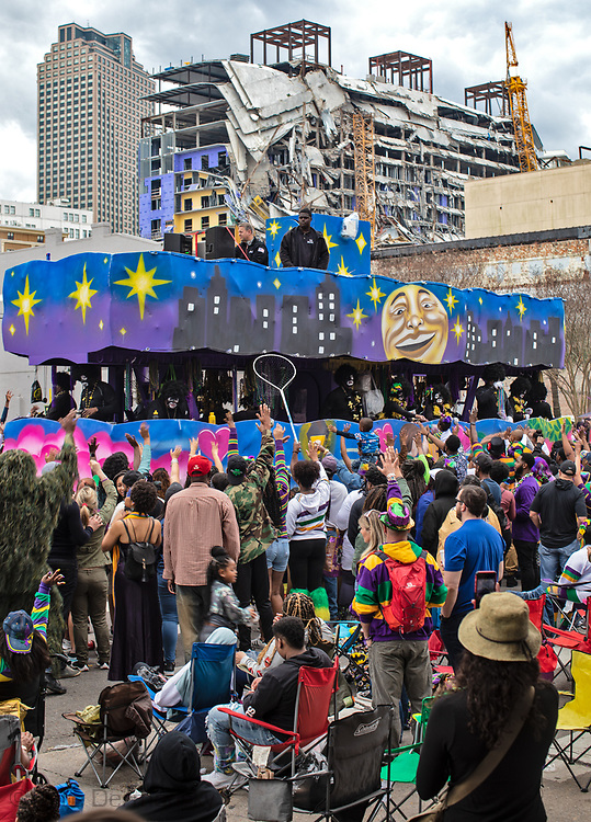 People at the Zulu Parade on Mardi Gras  morning in New Orleans  near the partially collapsed Hard Rock Cafe  Hotel. The hotel collapsed while it was still underc construction  on Oct. 12, 2019, killing at least three workers. Two of the bodies remain trapped inside.