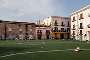 Palermo:  Kalsa neighborhood, playing football in Piazza Magione