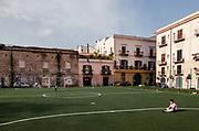 Palermo:  Kalsa neighborhood, playing football in Piazza Magione