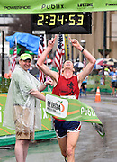 Publix Georgia Marathon male winner David McWilliams, of Decatur, crosses the finish line with an unofficial time of 2:34.54 Sunday, March 22, 2015, in Atlanta. Despite a steady rain, runners from 46 states and 22 countries participated in the Publix Georgia Marathon & Half Marathon. David Tulis / AJC Special