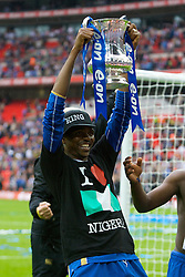 LONDON, ENGLAND - Saturday, May 17, 2008: Portsmouth's Nwankwo Kanu celebrates with the trophy after his side beat Cardiff City 1-0 during the FA Cup Final at Wembley Stadium. (Photo by David Rawcliffe/Propaganda)