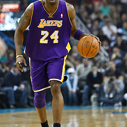 December 29, 2010; New Orleans, LA, USA; Los Angeles Lakers shooting guard Kobe Bryant (24) against the New Orleans Hornets during the first half at the New Orleans Arena.   Mandatory Credit: Derick E. Hingle