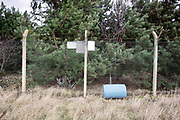 © Licensed to London News Pictures. 22/10/2017. Bawdsey, UK.  A barrel leans against a perimeter fence. RAF Bawdsey, WW2 radar and Cold-War Bloodhound Surface to Air Missile (SAM) base at Bawdsey Ferry, Suffolk, today 22nd October 2017. The base was decommissioned in 1991 leaving behind a deserted base.  Photo credit: Stephen Simpson/LNP