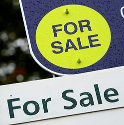 File photo dated 14/10/14 of property sale signs, as home ownership among young families has halved across large swathes of England in the space of a generation, according to analysis by a think-tank.