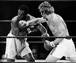 'Smokin' Joe' Frazier (born January 12, 1944 in Beaufort, South Carolina) 1968 world heavyweight boxing champion, was the first American boxer to win both the Olympic gold medal and the professional world title in the heavyweight division. Frazier is considered one of the greatest heavyweights of all time, but he is perhaps most famous for his trilogy of fights Ali, the first of which, won by Frazier in a unanimous decision, has often been called one of boxing's greatest bouts. Frazier was known for a relentless pursuit of opponents, quickly cutting off angles of escape using a chugging locomotion reminiscent of a train's advance up a hill. The contrast with Ali's dancing, non-linear style could not have been greater. Winner of Olympic 1964 Tokyo Gold medal for Boxing - Heavyweight. He had a band called 'Joe Frazier & the Knockouts' that released songs in the 'soul' genre. In the 1990s, he trained award winning artist Richard T. Slone to box. Operated a boxing gym in North Philadelphia since the late 1960s, used by fighters such as Michael Spinks, Meldrick Taylor, his son Marvis Frazier, and Bernard Hopkins. Father of 11 children..PICTURED: Jul 2,1973 - London, England, United Kingdom - JOE FRAZIER (Left) and Australian boxer JOE BUGNER. In 1973 Bugner lost twelve round decisions to  Ali and Joe Frazier. Although the scorecards in these fights were lopsided, Bugner fought well in both bouts and he won the respect of the boxing media and public alike. After their bout, Ali declared that Bugner was capable of being world champion. The fight with SmokinÔøΩ Joe in July 1973 at Earls Court in London was deemed a classic. After being knocked down by a tremendous left hook in the tenth round, Bugner arose and hurt Frazier to close the round. Many regard the Frazier bout as being Bugner's best career performance.