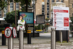"""© Licensed to London News Pictures . 16/09/2020. Bolton , UK . GV of Victoria Square in Bolton Town Centre with signs cautioning visitors to """" Stop a Bolton Lockdown """" , that """"Bolton is open for business """" that skateboarding is prohibited and that details locally prohibited behaviours . The number of recorded cases of Coronavirus has gone over 200 in a single day , in Bolton . Photo credit : Joel Goodman/LNP"""