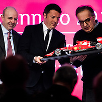 Milan, Italy - 04-01-2016: Raffaele Jerusalmi, Borsa Italiana Executive director (L), Matteo Renzi, Prime Minister of Italy (C) and Sergio Marchionne, Chairman/CEO of Ferrari and Fiat Chrysler Automobiles (R), on the day of the first quotation of Ferrari S.p.A. at Milan stock exchange