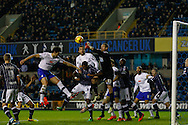 Picture by David Horn/Focus Images Ltd +44 7545 970036<br /> 28/01/2014<br /> Stephen Bywater of Millwall punches the ball away under pressure during the Sky Bet Championship match at The Den, London.