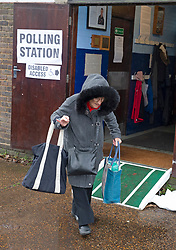 ©Licensed to London News Pictures 12/12/2019. <br /> Bromley ,UK. An elderly lady with her shopping bags after voting. People battle against the wet weather to vote in the UK General Election at St Augustine scout hall, Bromley, South East London.          Photo credit: Grant Falvey/LNP
