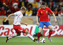 Stephane GRICHTING (L) challenges Fernando TORRES during the 2010 FIFA World Cup South Africa Group H match between Spain and Switzerland at Durban Stadium on June 16, 2010 in Durban, South Africa.