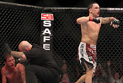 October 8, 2011; Houston, TX.; USA;  UFC Lightweight Champion Frankie Edgar celebrates his knockout win over challenger Gray Maynard at UFC 136 at the Toyota Center in Houston, TX.