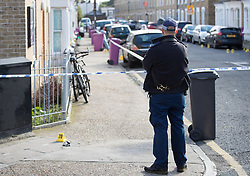 © Licensed to London News Pictures. 30/09/2017. London, UK. A police officer stands at a cordon after a man was fatally stabbed in Bow, East London. Police were called at 2:30 am on Saturday, 30 September to reports of a disturbance in E3. Officers found a 21-year-old man suffering from stab injuries. He was treated at the scene by London's Air Ambulance before being taken to an east London hospital where he died. Detectives from the Homicide and Major Crime Command are investigating. Photo credit: Peter Macdiarmid/LNP