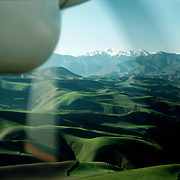 20 May 1976<br /> Very rounded green hills. Snow-capped mountains, just visible in background.