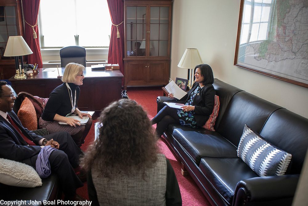 Representative Pramila Jayapal (D-WA, 7), right, and Danielle Fulfs, her Legislative Assistant, second from right, take their first constituent meeting of the day, speaking to Mary Fertakis and Stephen Blanford, a Seattle School Board Director, both of the Washington State School Directors Association, on Tuesday, January 31, 2017.  Among other topics of concern, they discussed the potential ramifications of President Trump's immigration and border security policies.  John Boal photo/for The Stranger