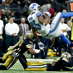 Dec 4, 2016; New Orleans, LA, USA; Detroit Lions tight end Eric Ebron (85) is upended by New Orleans Saints free safety Jairus Byrd (31) and strong safety Kenny Vaccaro (32) during the second quarter of a game at the Mercedes-Benz Superdome. Mandatory Credit: Derick E. Hingle-USA TODAY Sports