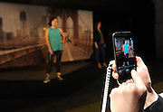 The Duo Camera feature of the new HTC One (M8), the company's latest flagship smartphone, is demonstrated in New York, Tuesday, March 25, 2014. (Photo by Diane Bondareff/Invision for HTC/AP Images)