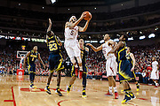 January 9, 2014: Terran Petteway (5) of the Nebraska Cornhuskers gets fouled by Caris LeVert (23) of the Michigan Wolverines at the Pinnacle Bank Arena, Lincoln, NE. Michigan defeated Nebraska 71 to 70.