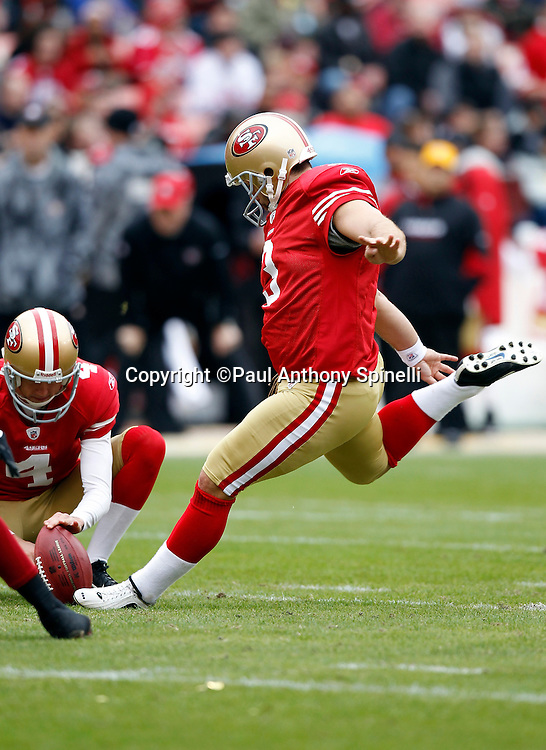 San Francisco 49ers place kicker Jeff Reed (3) kicks a 39 yard second quarter field goal that gives the Niners a 10-0 lead during the NFL week 17 football game against the Arizona Cardinals on Sunday, January 2, 2011 in San Francisco, California. The 49ers won the game 38-7. (©Paul Anthony Spinelli)