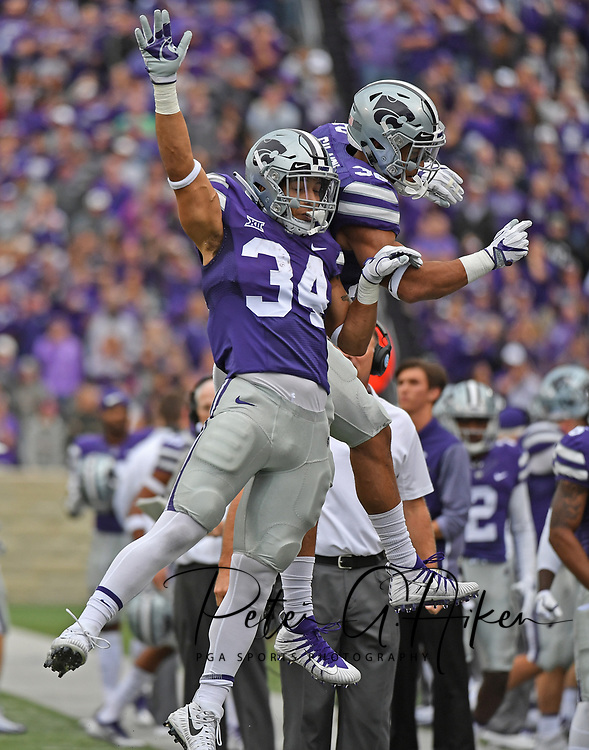 MANHATTAN, KS - OCTOBER 21:  Running back Alex Barnes $34 of the Kansas State Wildcats celebrates with teammate Justin Silmon #32 after scoring a touchdown against the Oklahoma Sooners during the first half on October 21, 2017 at Bill Snyder Family Stadium in Manhattan, Kansas.  (Photo by Peter G. Aiken/Getty Images) *** Local Caption *** Alex Barnes;Justin Silmon