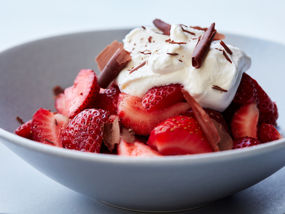 Fresh Strawberries and Homemade Whipped Cream with Dark Chocolate Shavings