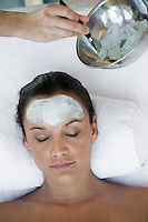 Woman having facial treatment at health spa
