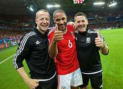 LILLE, FRANCE - Friday, July 1, 2016: Wales' captain Ashley Williams celebrates with Medical Officer Doctor Jon Houghton [L] and masseur David Rowe [R] after a 3-1 victory over Belgium and reaching the Semi-Final during the UEFA Euro 2016 Championship Quarter-Final match at the Stade Pierre Mauroy. (Pic by David Rawcliffe/Propaganda)