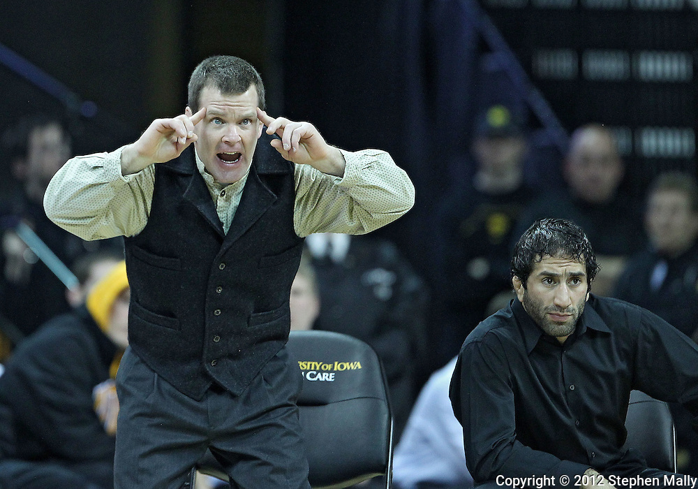 January 07, 2011: Iowa assistant coach Terry Brands signals to Bobby Telford during the heavyweight bout in the NCAA wrestling dual between the Oklahoma State Cowboys and the Iowa Hawkeyes at Carver-Hawkeye Arena in Iowa City, Iowa on Saturday, January 7, 2012. Gelogaev won 10-2.