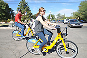 Jessica Hersh-Ballering, the alternative transportation manager for the University of Arizona, joins other volunteers as they ride the Tugo bikes to their stations.