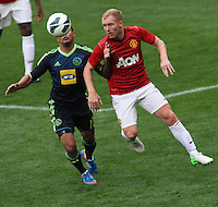 Manchester United's Paul Scholes against Ajax Cape Town's Granwald Scott during their International friendly match at Cape Town Stadium,South Africa