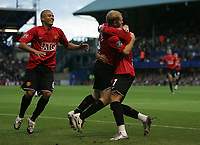 Photo: Lee Earle.<br /> Portsmouth v Manchester United. The FA Barclays Premiership. 15/08/2007.United's Wes Brown (L) joins Cristiano Ronaldo in congratulating Paul Scholes after he scored their opening goal.