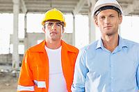 Portrait of confident male architects at construction site