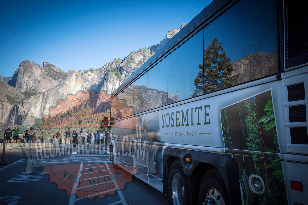 A tour bus stops at Tunnel View inside Yosemite National Park on Sunday, September 22, 2019 in Yosemite, California. (Alex Menendez via AP)