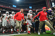 GLENDALE, AZ - JANUARY 01: Head coach Urban Meyer of the Ohio State Buckeyes runs onto the field before the start of the BattleFrog Fiesta Bowl against the Notre Dame Fighting Irish at University of Phoenix Stadium on January 1, 2016 in Glendale, Arizona.  (Photo by Jennifer Stewart/Getty Images)