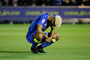 AFC Wimbledon striker Lyle Taylor (33) looking at floor during the EFL Sky Bet League 1 match between AFC Wimbledon and Milton Keynes Dons at the Cherry Red Records Stadium, Kingston, England on 22 September 2017. Photo by Matthew Redman.