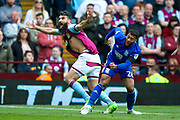 Aston Villa midfielder Mile Jedinak (25) has his shirt ripped off his back by Birmingham City  midfielder David Davis (26)  during the EFL Sky Bet Championship match between Aston Villa and Birmingham City at Villa Park, Birmingham, England on 23 April 2017. Photo by Simon Davies.