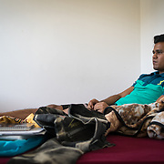 PALM SPRINGS, FLORIDA, JANUARY 14, 2018<br /> Mamudul Hasson, 21, on the mattress he sleeps on in his uncle's house. Hassan is a Rohingya Muslim refugee who just arrived to the United States three weeks ago.<br /> (Photo by Angel Valentin/Freelance)