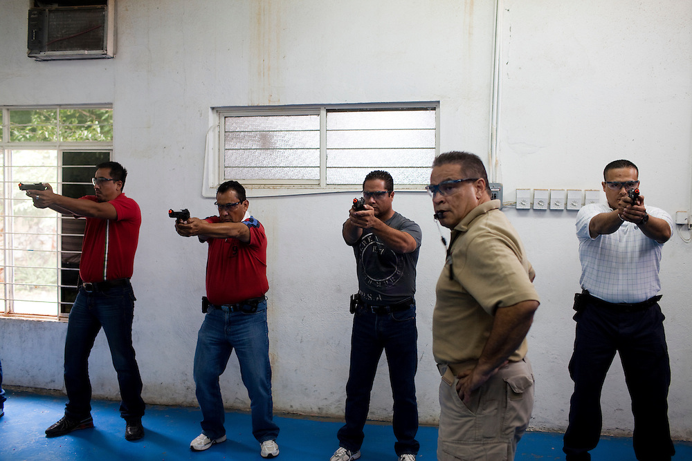 A group of men take classes at Falcone's System International, a body guard training school in the state of Taumalipas.  These men are training to act as the guards for the incoming mayor of Ciudad Victora.