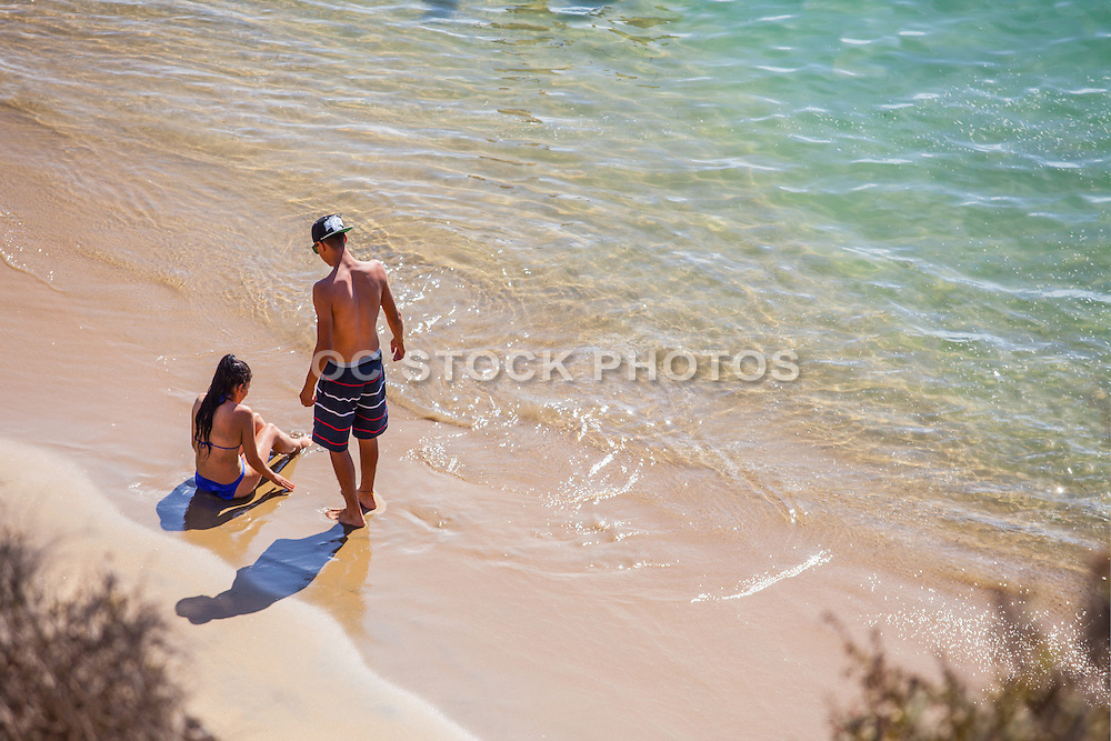 Young Couple on the Beach During Summer