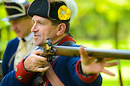 8/18/12 1:08:33 PM - Warwick, PA. -- Chuck Faust of East Greenville, Pennsylvania demonstrates the use of a rifle during a revolutionary war reenactment at the Moland House August 18, 2012 in Warwick, Pennsylvania. -- (Photo by William Thomas Cain/Cain Images).