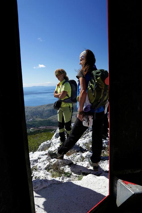 Anamaria and Valentina at 'Vickov Stup' shelter (Vicko's Column') on the Mosor mountain, Croatia.