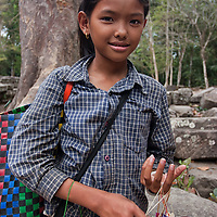 A cambodian girl selling handmade items in Preah Khan.