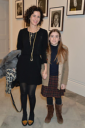 MOLLIE DENT-BROCKLEHURST and her daughter VIOLET WARD at a private view of photographs by David Bailey entitled 'Bailey's Stardust' at the National Portrait Gallery, St.Martin's Place, London on 3rd February 2014.