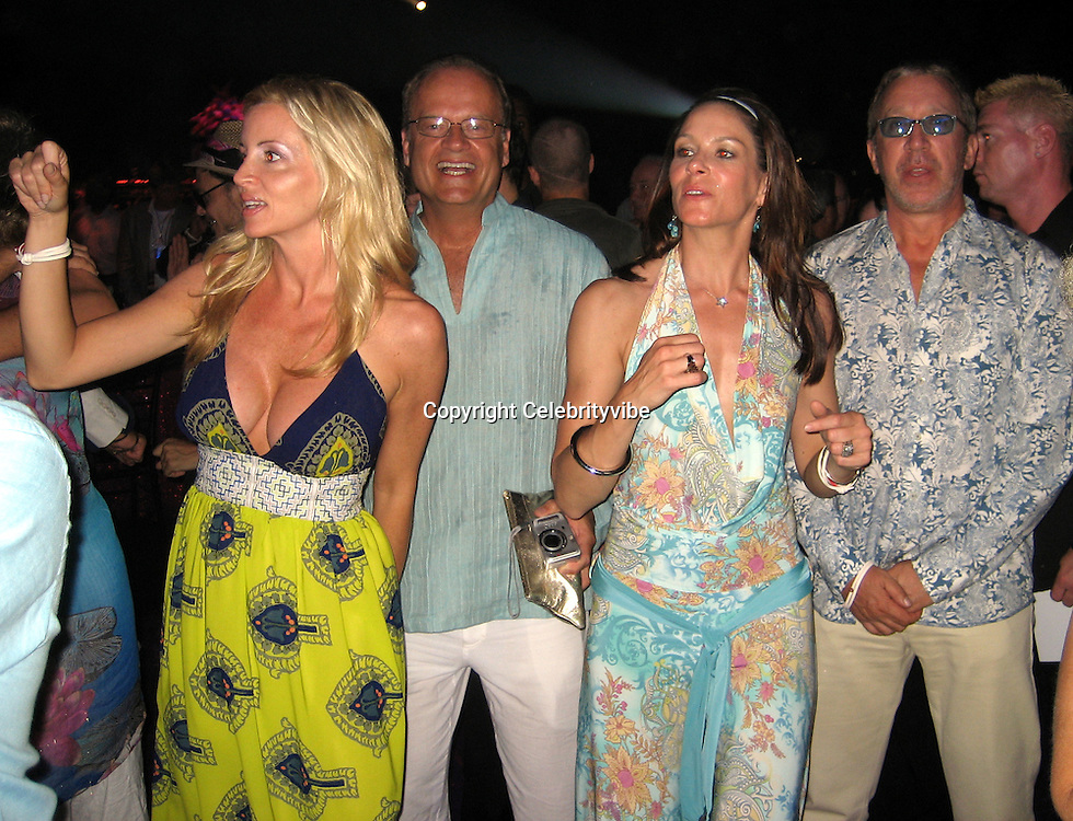 **EXCLUSIVE**.Kalsey Grammer with Tim Allen and their wives..Silly 70's Party with performances by Aerosmith, Earth Wind, Fire & Village People & Stevie Wonder.Opening of Cain at The Cove Hotel.Grand Ballroom.Atlantis Hotel.Paradise Island, Bahamas.Saturday, May 12, 2007 .Photo By Celebrityvibe.To license this image please call (212) 410 5354; or.Email: celebrityvibe@gmail.com ;.