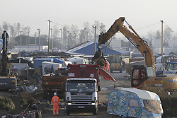 October 27, 2016 - Calais, Nord-Pas-de-Calais-Picardie, France - A bulldozer removes the huts and tents in the Jungle. The 4th day of the eviction of the jungle in Calais saw the continue demolition of the huts in the Jungle, as well as the first arrests of people who didn'Äôt leave and some minor clashes with activists opposed to the eviction. (Credit Image: © Michael Debets/Pacific Press via ZUMA Wire)