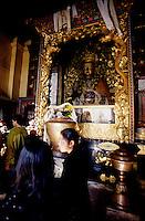 Kathmandu, 13 February 2005. Pilgrims visiting the Buddha statue in Swayambhunath Temple